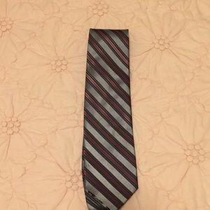 Striped red green grey tie